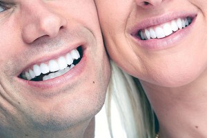 man and woman smiling after cosmetic treatments